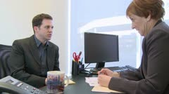 Young employee tries to explain (1 of 2) - stock footage