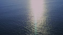 Aerial ocean view of sea with sunlight - stock footage