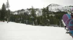 Snowboarding girl Stock Footage
