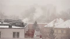 Blizzard 03 smoking chimney Stock Footage