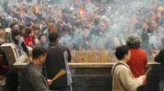 People burn incense in temple 005 Stock Footage