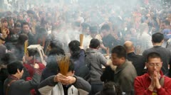 People burn incense in temple 004 Stock Footage