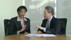 Co-workers discuss presentation (7 of 7) - stock footage