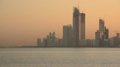 United Arab Emirates, Abu Dhabi, City Skyline at dawn Stock Footage