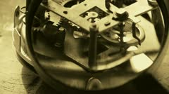 Magnifying glass to enlarge internal structure of Watch,bearings,gears. - stock footage