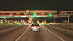 Driving through Bay Bridge Toll Plaza at Night Stock Footage