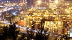 Busy City Night Timelapse. Cargo Container Terminal and Busy Traffic on Highway. Stock Footage