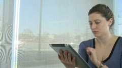 Young woman on tablet computer (2 of 4) Stock Footage