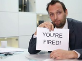 Businessman in office gets paper sheet with YOU`RE FIRED text NTSC Stock Footage