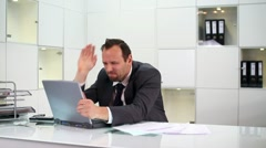Angry businessman hitting and throw away laptop in the office HD Stock Footage