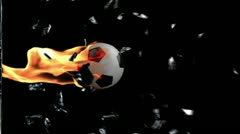 Soccer Ball on fire breaking glass - stock footage
