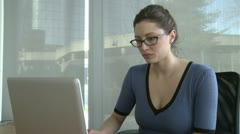Young female professional under stress - stock footage