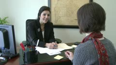 Signing paperwork (2 of 2) - stock footage