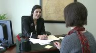 Stock Video Footage of Signing paperwork (2 of 2)