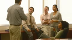 Young business collegues discussing work in office Stock Footage