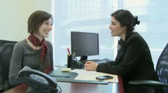 Female coworkers have a friendly conversation - stock footage