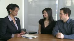 Young couple listens to real estate agent (3 of 3) - stock footage