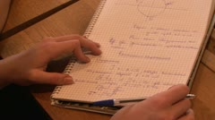 Write in notebook Stock Footage