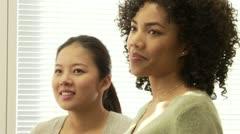 Closeup portrait of two business women talking in office Stock Footage