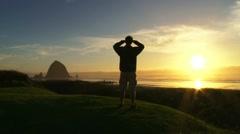 Person Enjoying Ocean Sunset 1 - stock footage