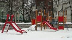 Snowy Suburb 08 playground Stock Footage