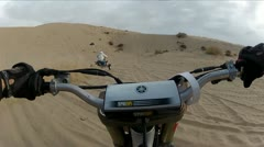Quad at sand dunes follow HD0033 Stock Footage