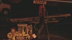Jetway Worker Refueling Jet at Night 2 Stock Footage