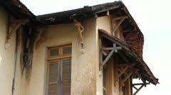 French Colonial: MCU Tilt down side of old French Colonial building in Asia - stock footage