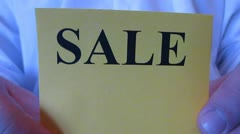 Sale all for 99 cents from men Stock Footage