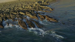 Aerial view of ocean waves and coastal rock, USA Stock Footage