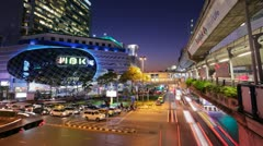 TIMELAPSE - TRAFFIC AND MBK CENTER AT NIGHT Stock Footage