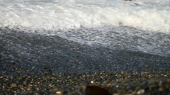 Waves rolling over rocky shore Stock Footage