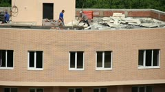Workers build on the building site Stock Footage