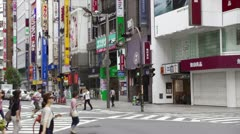 Pedestrians Crossing Street at Intersection in Downtown Shinjuku, Tokyo - Japan Stock Footage