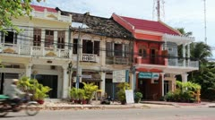 French Colonial: WS Pan Along Row of French Colonial Townhouses in Cambodia Stock Footage