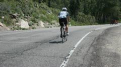Bike on mountain road P HD 0674 Stock Footage