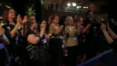 Crowd applauds at event Stock Footage
