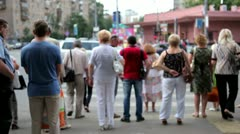 Crowds crossing urban street Stock Footage