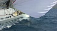 Sailboat racing with spinnaker Stock Footage