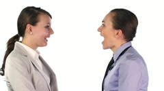 Two young businesswomen arguing, isolated on white HD - stock footage