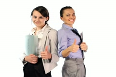 Successful businesswomen showing thumbs up, ok sign, isolated NTSC - stock footage