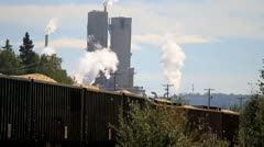 Train passing pulp mill Stock Footage