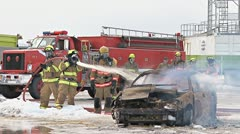 Firefighters Extinguishing Flames in a Burning Car Stock Footage