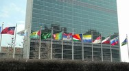 Stock Video Footage of UN United Nations NY New York headquater tight pan 1080 24p flags