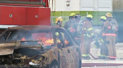 Firefighters Preparing to Extinguish a Burning Car Stock Footage