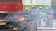 Stock Video Footage of Firefighters Preparing to Extinguish a Burning Car
