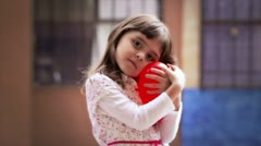 Little girl with heart - stock footage
