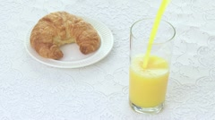 Stock Video Footage of Orange Juice with Croissant t 05