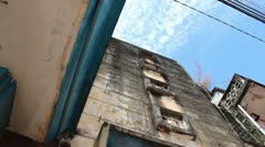 Low angle tilt down old retro deco vintage cinema house in Asia - stock footage