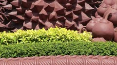 CU tilt up retro kitch durian fruit statue in Asia Stock Footage